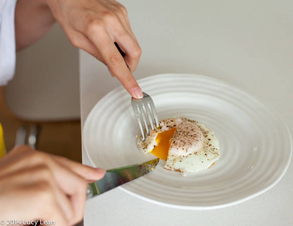 cutting in to fried egg