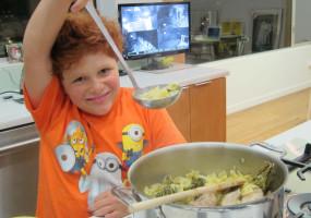 Remy ladles his chicken noodle soup